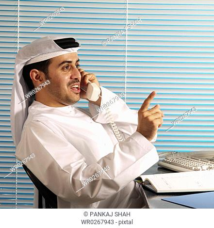 Businessman on the phone talking with hand gestures