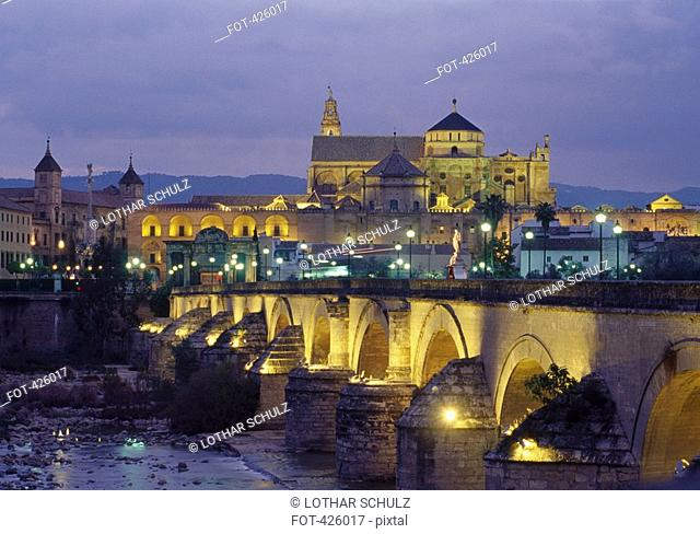 View of the La Mezquita Mosque and Cathedral over a bridge, Cordoba, Spain