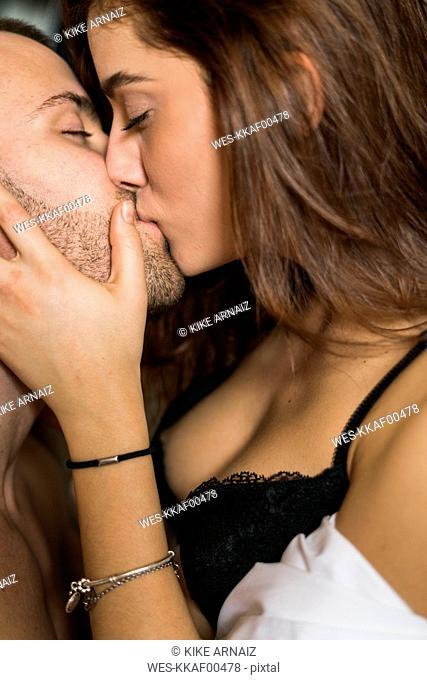 Amorous couple kissing passionately