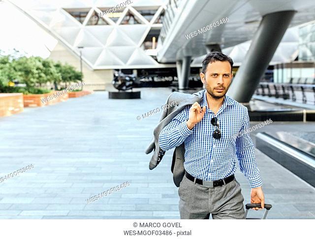 Businessman walking through the city
