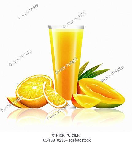 Fresh mango and orange and glass of juice