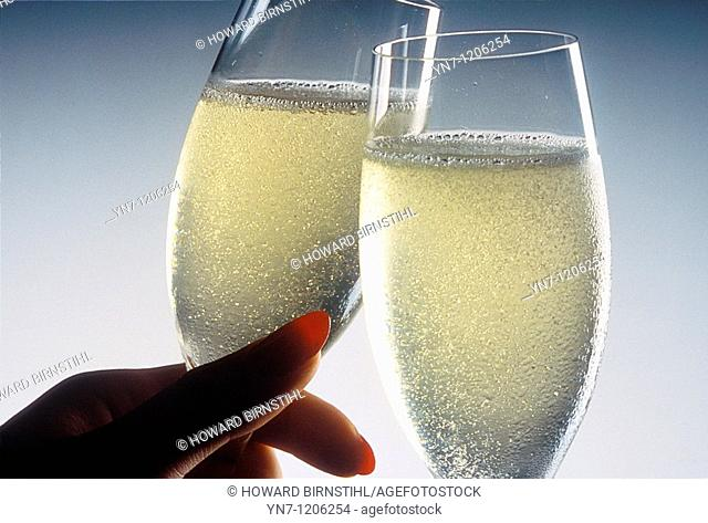 Close up of champaigne glasses toasting