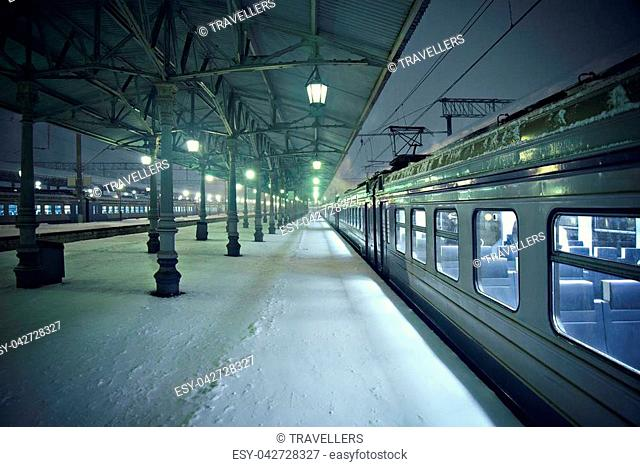 Night view of the station platforms at snowy cold winter time