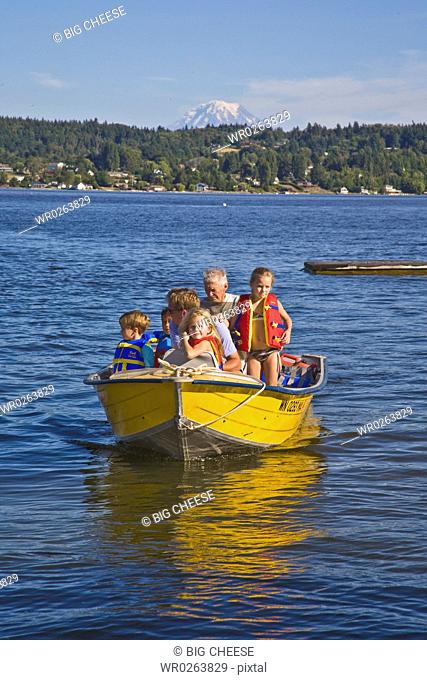 men and young children on motorboat ride