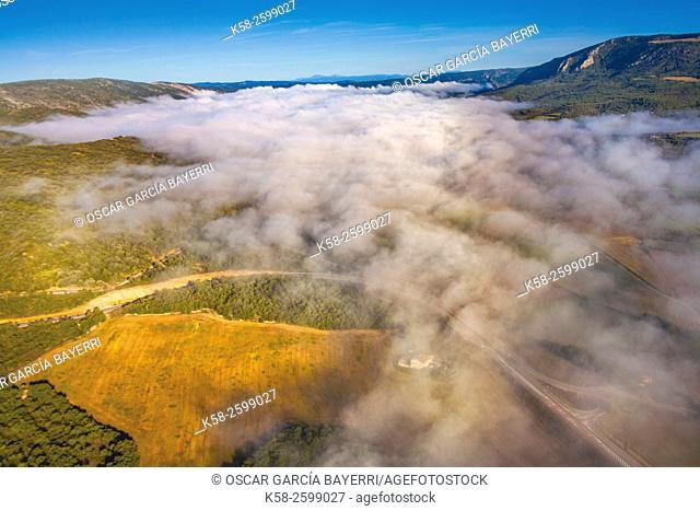 Aerial view from the clouds, Ager valley, Montsec mountain range, pre-Pyrenees mountains, Lleida province, Catalonia, Spain