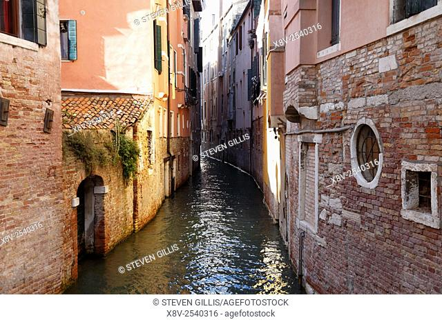 Decaying buildings down a narrow canal in Venice, Italy