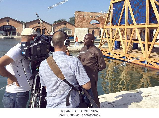 Kunlé Adeyemi (Nlé) from Nigeria during an interview in front of his triangular timber house swimming in a water basin at the arsenal grounds of the 15th...