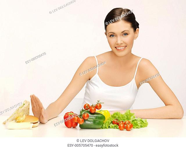 picture of beautiful woman with hamburger and vegetables