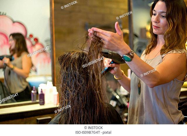 Hairstylist working in salon