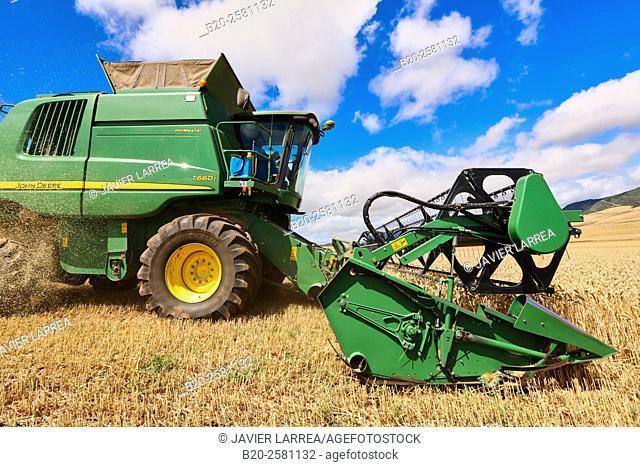 Combine harvester on field of wheat 'Learza' estate Near Estella, Navarre, Spain