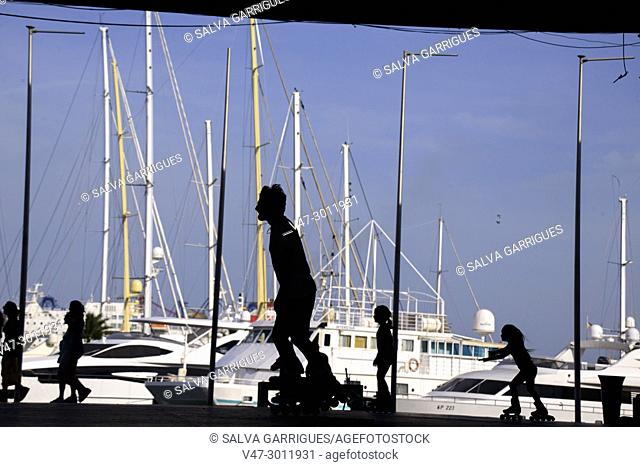 Silhouette of a boys skating in the port of Valencia, Spain, Europe