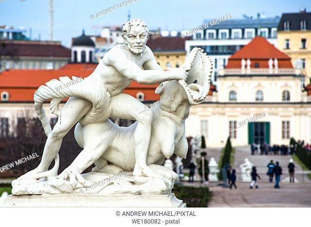 Sculpture of a man wrestling a crocodile in Belvedere Palace formal gardens, Vienna, Austria