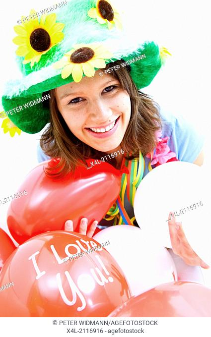Young woman with carnival decoration, I love you balloon (model-released)