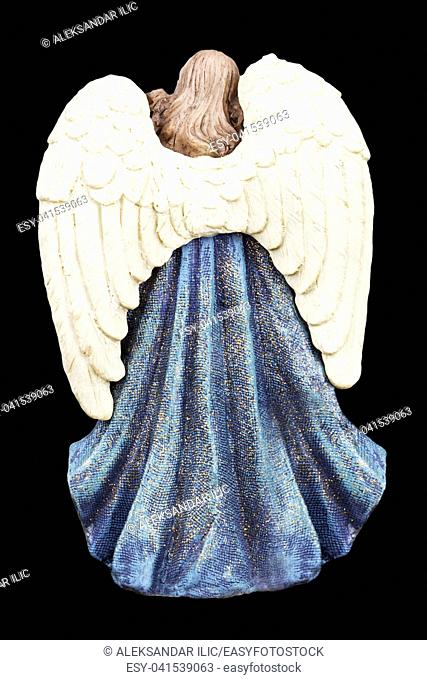 Angel With White Wings Standing Isolated On Black Background
