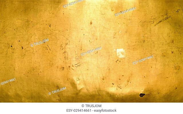 Abstract background from close up golden wall texture
