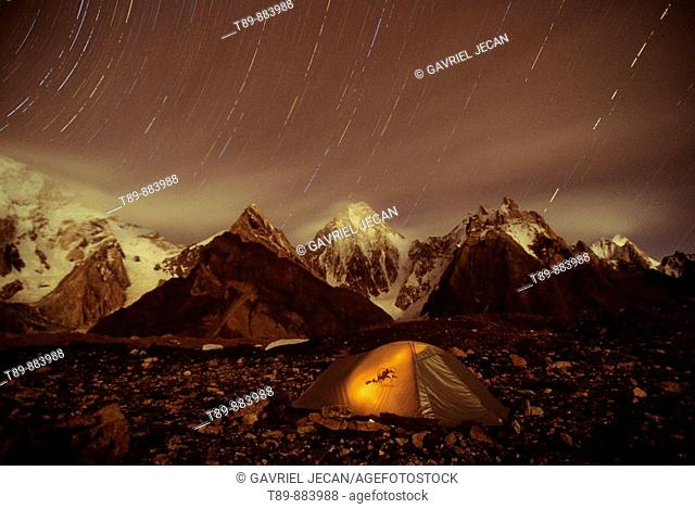 Tent and Star trail over 7000 TO 8000 meter Broad and Masherbrum in Hushe Peaks area of Karakoram Himalaya