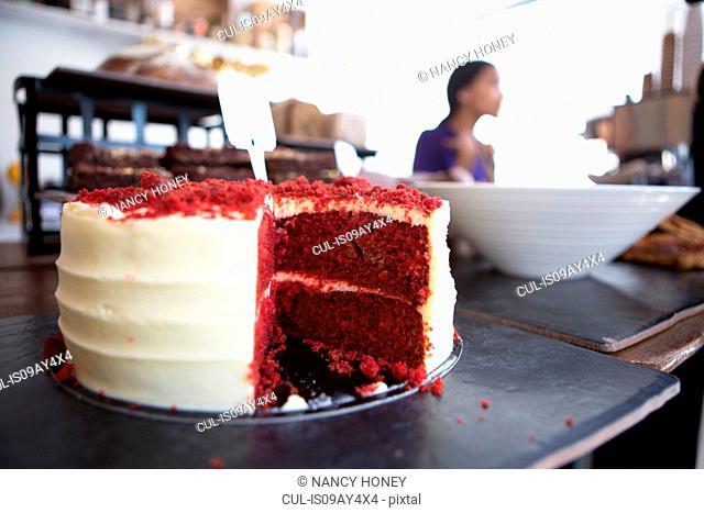 Red velvet cake on cafe counter
