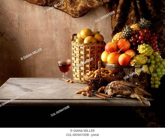 Still life of grouse, fruit, nuts and wine