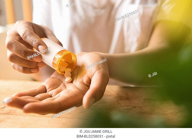 Hands of African American woman holding prescription medicine