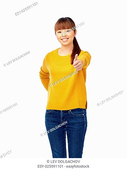 people, ethnicity and gesture concept - happy asian young woman showing thumbs up over white