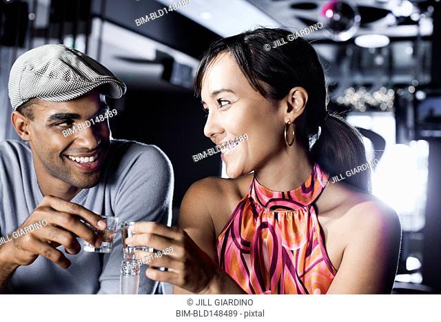 Couple toasting in nightclub