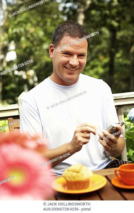 Portrait of a mature man holding a palmtop