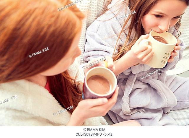 Girls having warm drink