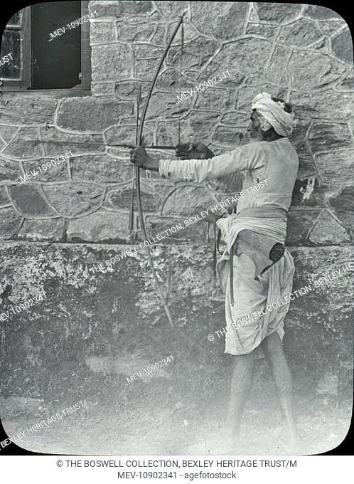 A black and white lantern slide of an archer. Slide number 28 of Box 221 Boswell Collection