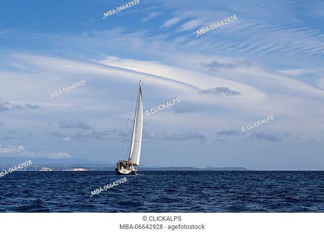 Sail boat in the clear sea under a blue summer sky Capo Testa Santa Teresa di Gallura Province of Sassari Sardinia Italy Europe