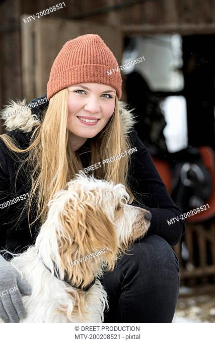 Portrait of a teenage girl with her dog, Bavaria, Germany