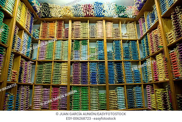 Shop of silk thread spools of different shades of color at Tetouan souk, Morocco