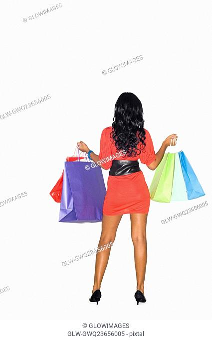 Rear view of a teenage girl holding shopping bags