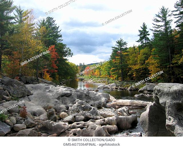 A landscape photograph of the Swift River featuring rocks that contain many potholes and scours, Roxbury, Maine. Image courtesy USGS. 1907