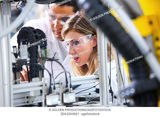 Researchers. Industrial Robot System. Tecnacomp Robotic cell manufacturing composite preforms Dry fiber preform manufacturing 3D Industry
