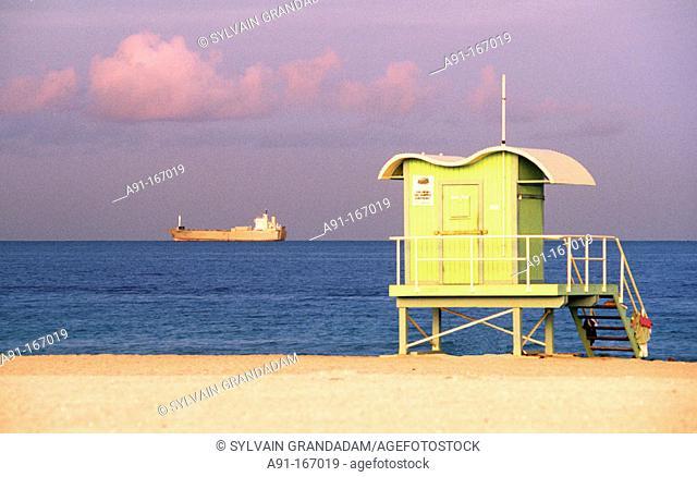 Cabin on the beach, ship at rear, Miami Beach, Fl, USA