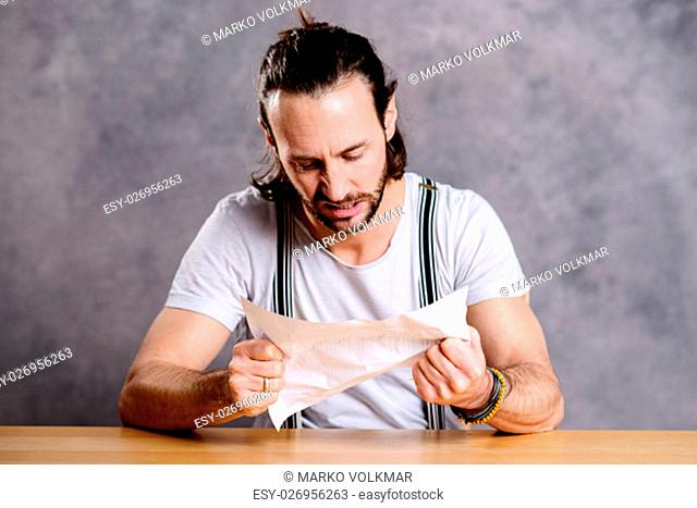 young man is annoyed about a letter