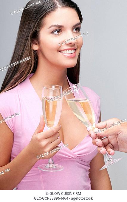 Couple toasting champagne flute