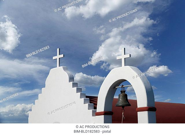 Low angle view of crosses on traditional roof