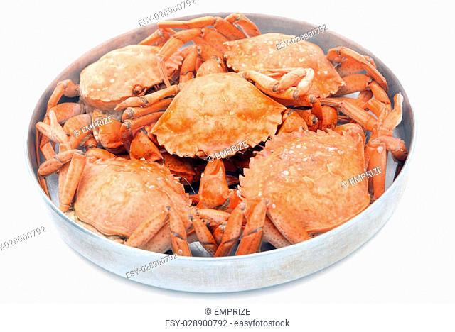 five red boiled crabs in a dish isolated on white background