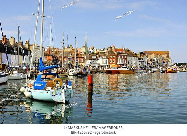 Sailboats docked in the old port of Weymouth, Dorset, England, UK, Europe