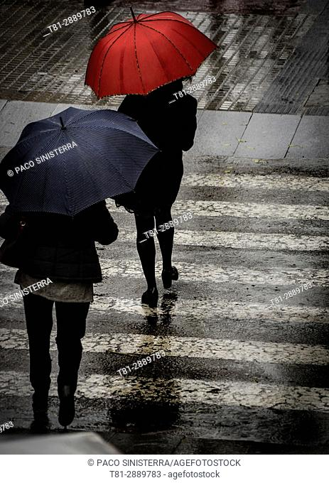 People walking in the rain, With umbrella, Madrid, Spain