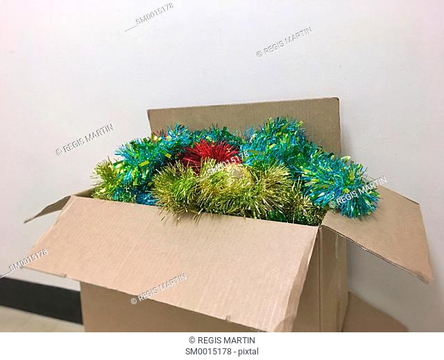 Christmas tinsel in cardboard boxes