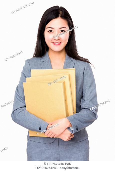 Businesswoman holding with document work