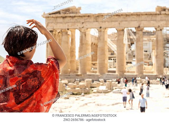 Tourists visit the ancient acropolis hill. Athens, Central Athens. Greece