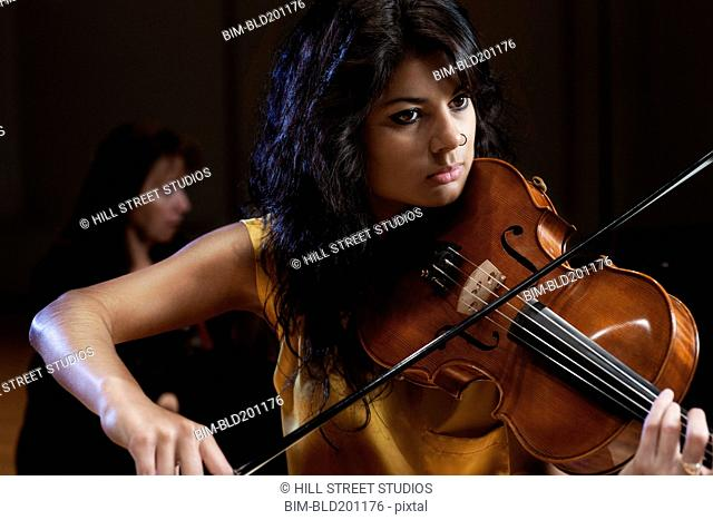 Hispanic woman playing violin