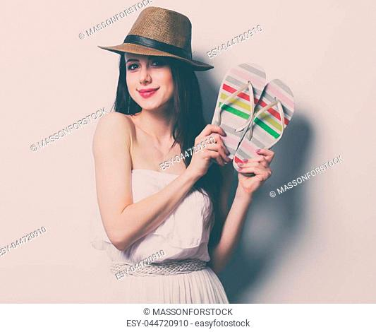 portrait of the beautiful young woman with sandals