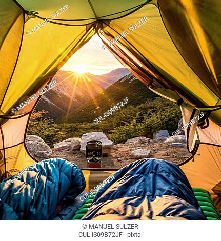 View from open tent at mountain sunrise, Nahuel Huapi National Park, Rio Negro, Argentina