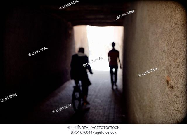 Silhouette of two people in an alley of the Medina, Marrakech, Morocco, Northern Africa