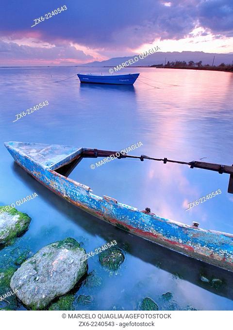 Old and new fishing boats. Alfacs Bay and Montsia Hills. Ebro River Delta Natural Park, Tarragona province, Catalonia, Spain