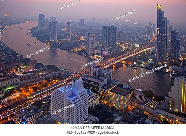 The skyline of Bangkok by night and view over the Chao Phraya River, Thailand